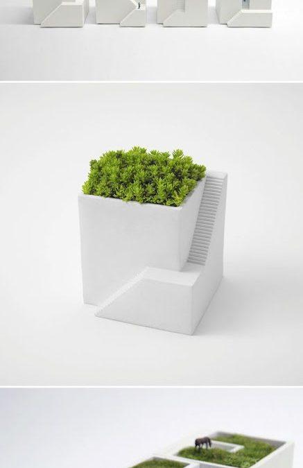 Modern virágcserepek épületmakettek formájában